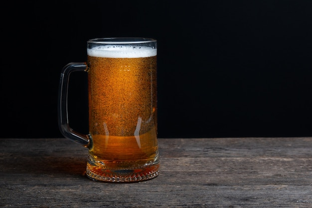 Glass of beer on a black