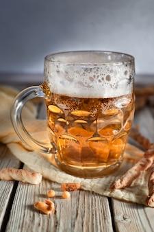 Glass of beer craft beerbeer in mug mug of beer and snacks pretzel