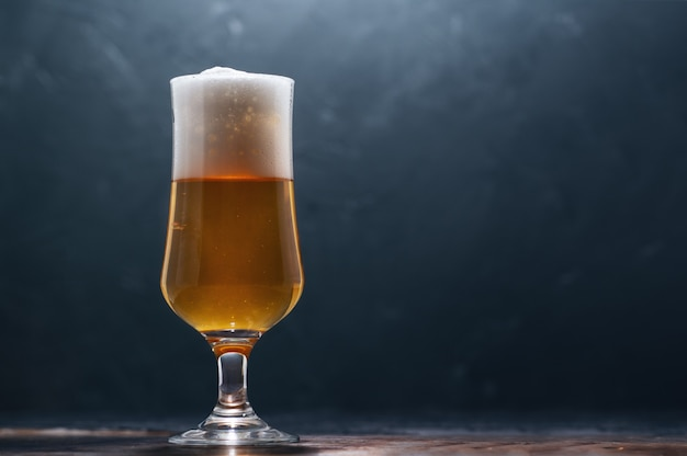 Glass of beer lager on a dark background