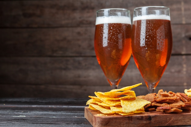 Glass beer and snacks