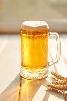 Glass of beer on a white wood