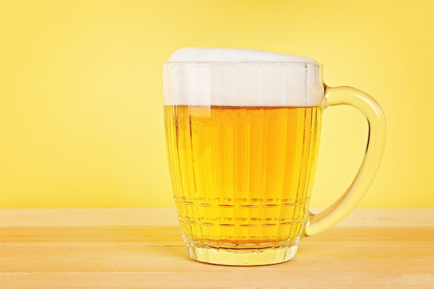 Glass beer on wood background with copy space.