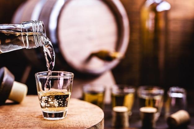 Glass being served with drink, known as cachaãƒâƒã'âƒãƒâ'ã'â§a,