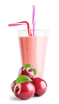 Glass of berry smoothie or yogurt with plums