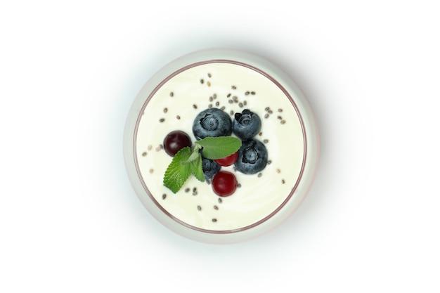 Glass of berry yogurt isolated on white background