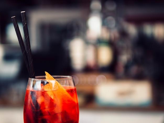Glass of beverage with orange slices
