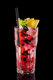 Glass of black currant, apple and cranberry ice lemonade isolated