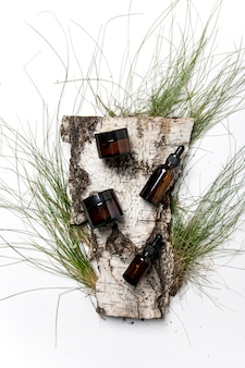 Glass bottle of cosmetic serum for the face