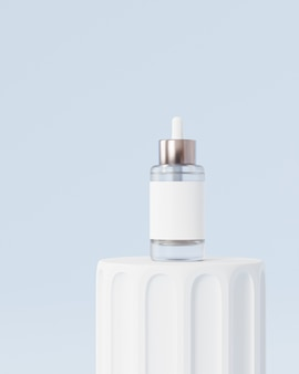 Glass bottle dropper with label for cosmetics on pillar