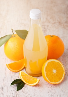 Glass  bottle of fresh mandarin tangerine juice