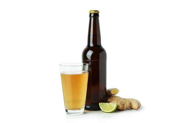 Glass and bottle of ginger beer on white background