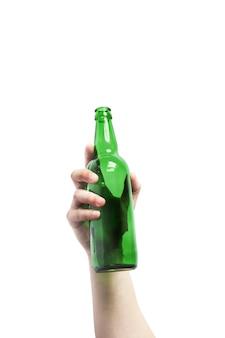 Glass bottle in hand