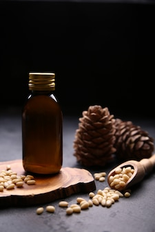 Glass bottle with oil and cedar nuts
