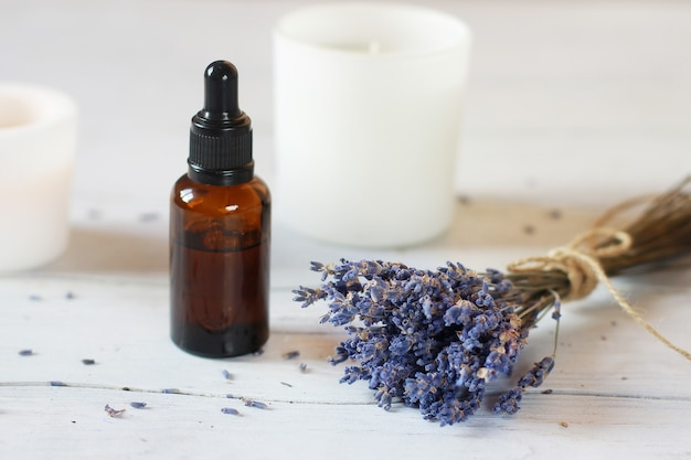 Glass bottle with organic cosmetics with a bunch of lavender. blogging beauty concept