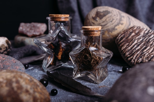 Glass bottles are filled with magical ingredients witchs table stones