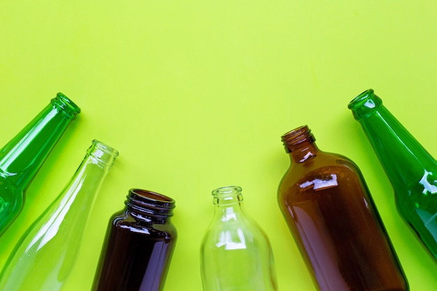 Glass bottles on green.