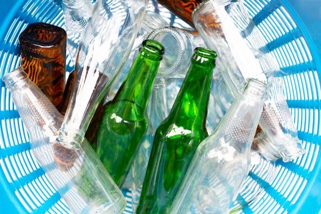Glass bottles in waste basket.