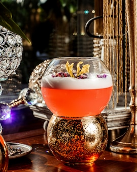 Glass bowl of coctail places over candle holder