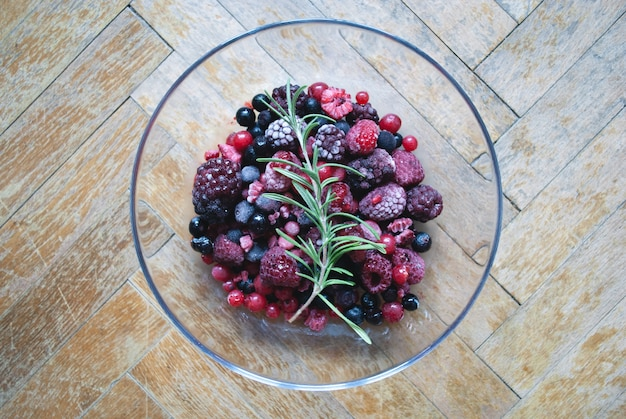 Glass bowl of frozen berries