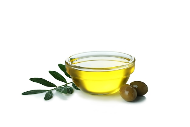 Glass bowl of olive oil isolated on white