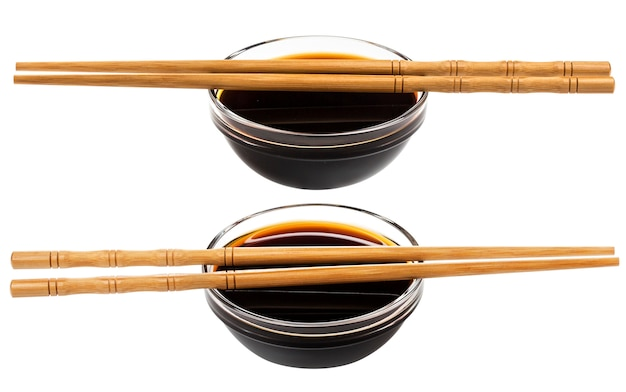 Glass bowl of soy sauce on white