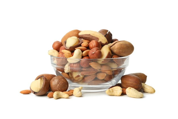Glass bowl with different nuts isolated on white background