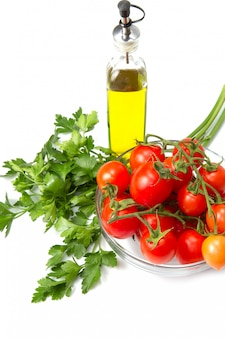 Glass bowl with fresh tomatoes and parsley