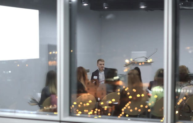 Behind the glass.business team discussing a new presentation.the concept of teamwork