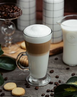 Glass of cappuccino with cream