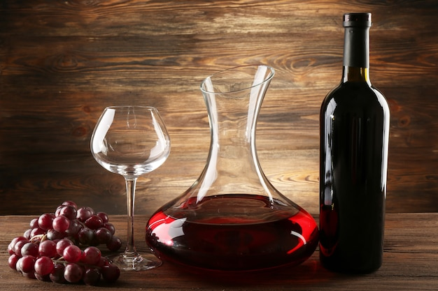 Glass carafe of wine on wooden