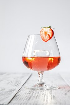 Glass of chamberyzette on the rocks on white backround