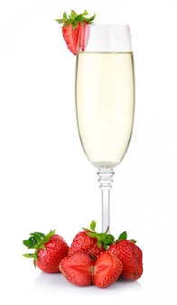 Glass of champagne and fresh strawberry isolated on white