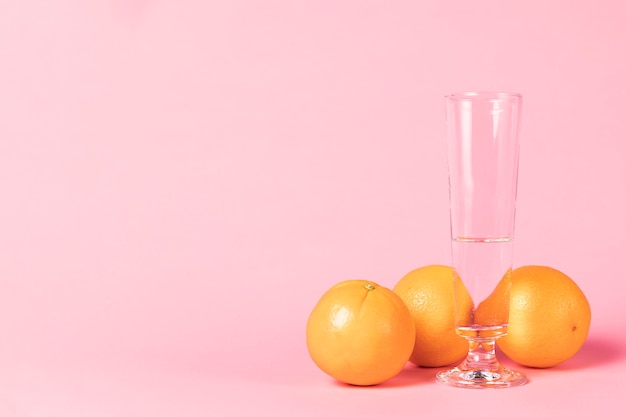 Glass of champagne and orange fruit