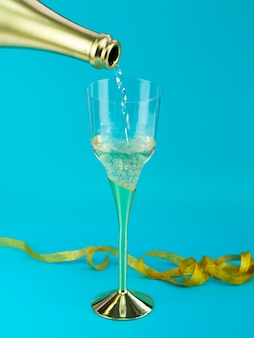 Glass of champagne with golden ribbon