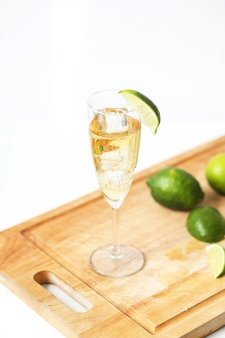 Glass of champagne with limes