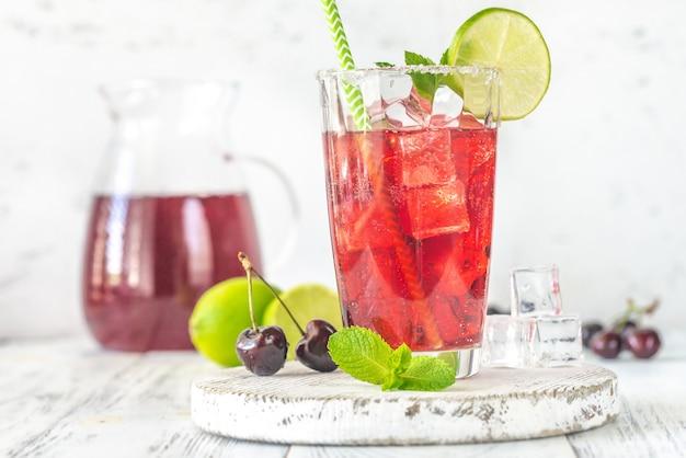Glass of cherry mojito