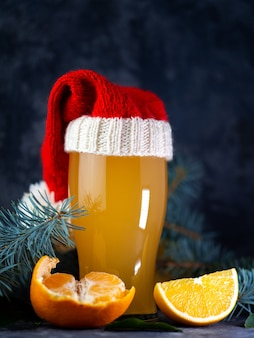 A glass of christmas craft beer with oranges