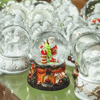 Glass christmas toys, souvenirs snowballs