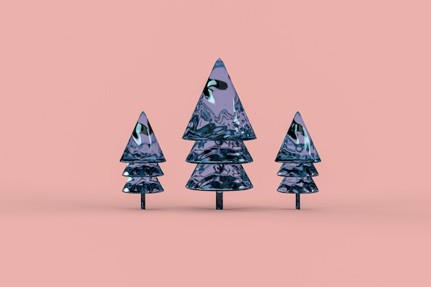 Glass christmas trees on pink surface