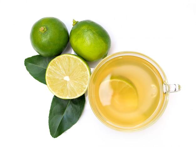 Glass of citrus lime lemon green tea cider with leaf.