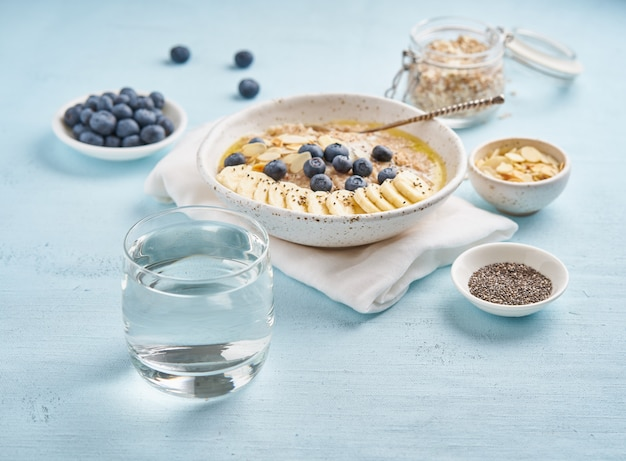 Glass of clean water and healthy diet breakfast with oatmeal