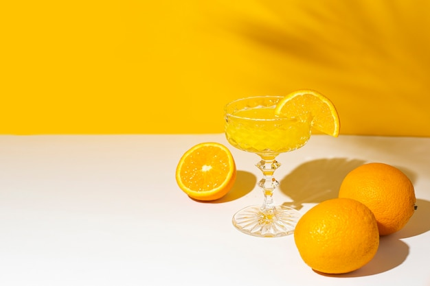Glass of cocktail or orange juice in the sunlight.