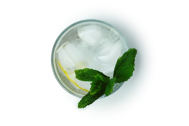 Glass of cocktail with lemon and mint isolated on white surface