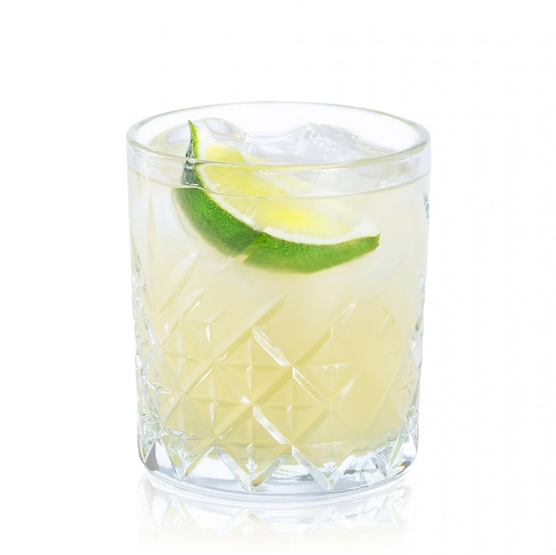 Glass of cocktail with reflection isolated on white