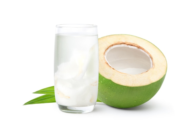 Glass of coconut juice with cut in half isolated on white background.