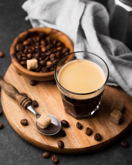 Glass of coffee on wooden board