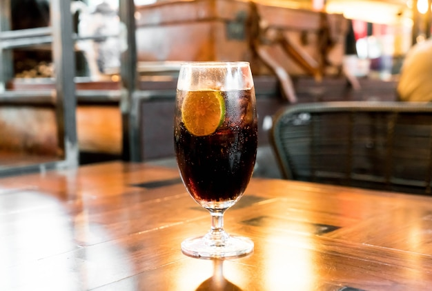 Glass of cola on table in restaurant