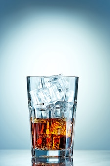 Glass of cola with ice cubes