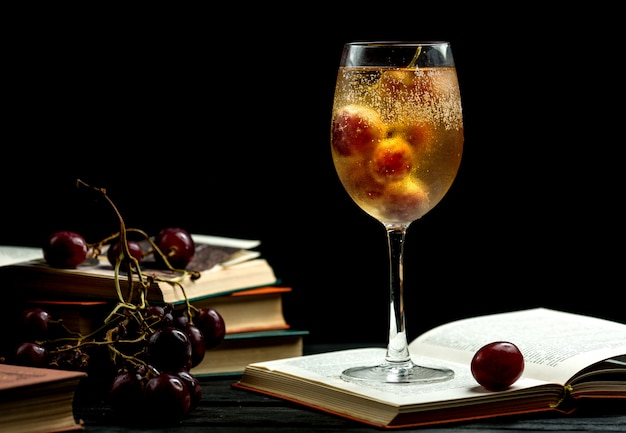 Glass of cold champagne on a book