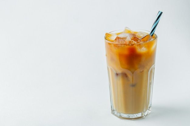 Glass of cold coffee on white background.